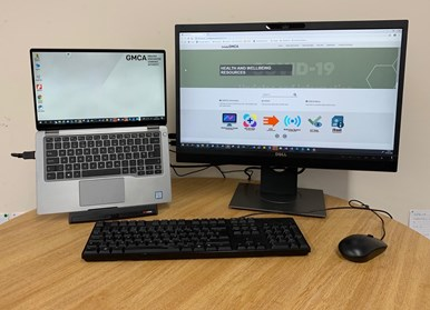 Image of remote working setup - laptop, screen, mouse and keyboard