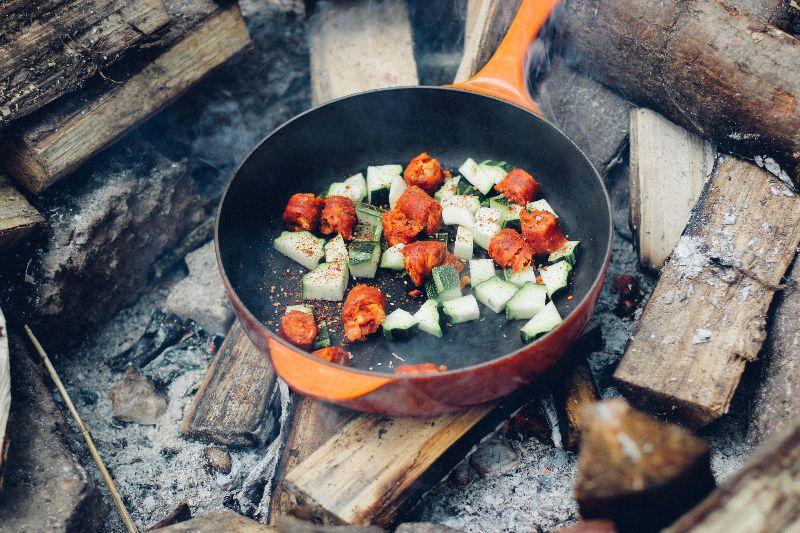 Cast iron cookware over a fire
