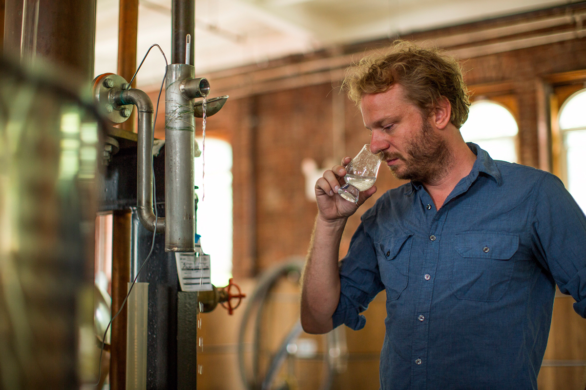 Colin Sampling Moonshine in the Distillery, Photo Credit: Andrew David Watson-Red Wing