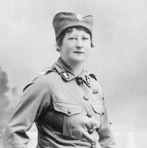 Studio portrait of ambulance driver Olive King in military uniform about 1916