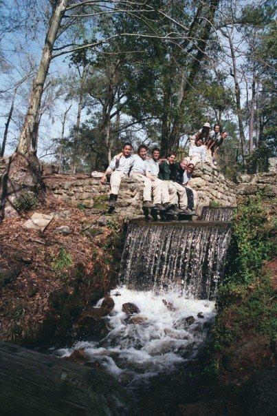 Gabriel and his Americorps team from 2004-2005 pose at a waterfall