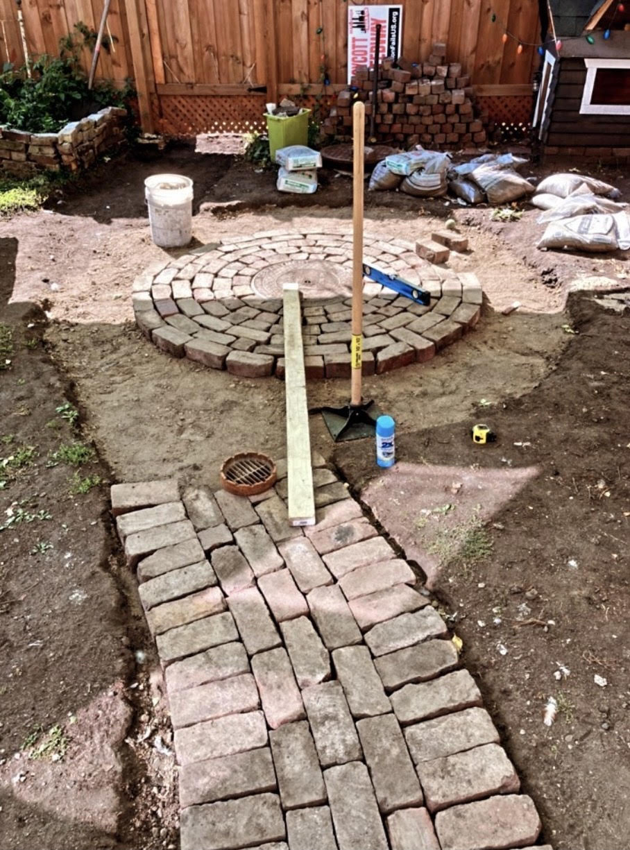 Reddish bricks laid out in a garden space pathway