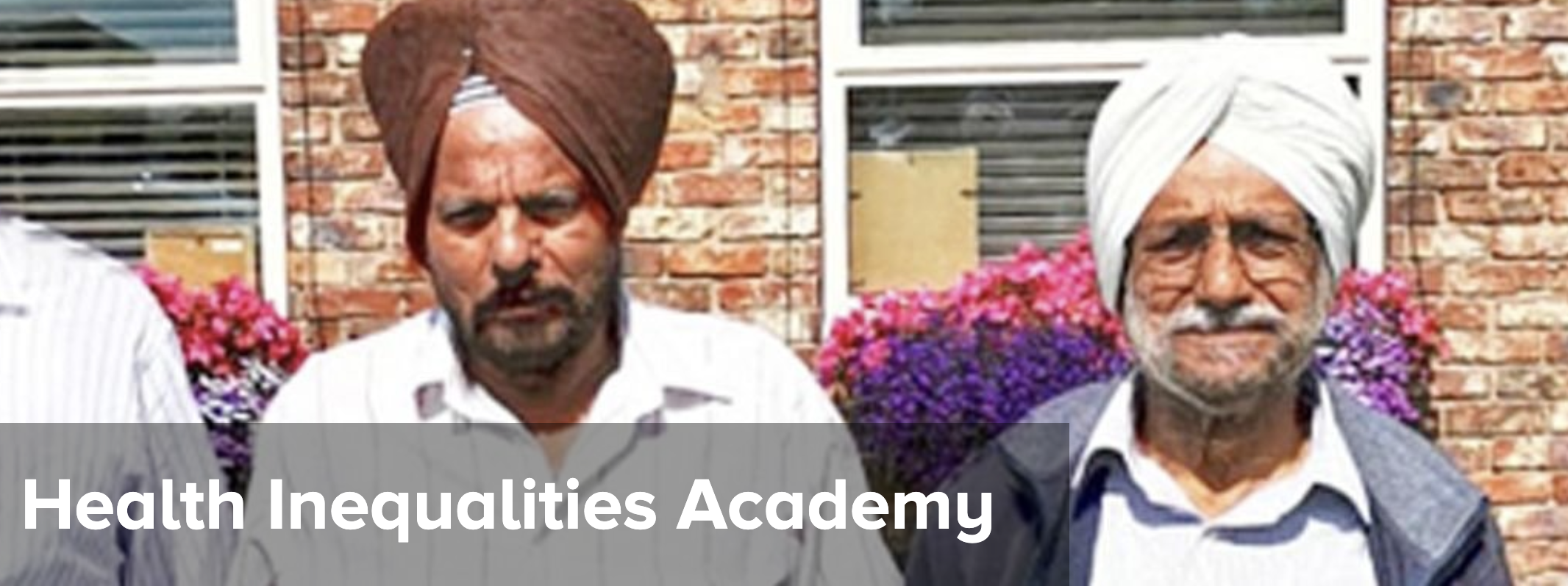 Two men in turbans with the words Health Inequalities Academy