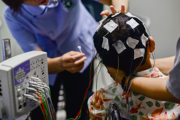 Patient receiving an electroencephalogram (EEG)