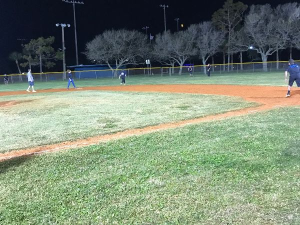 Outfielder tracks down a fly ball during Wednesday night kickball