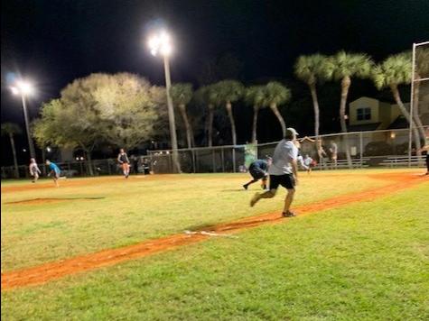 man running on bases during kickball