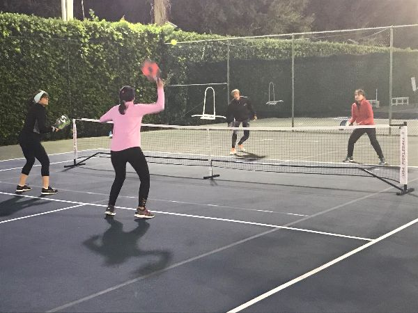 Ladies brace for the cold weather on Tuesday night's pickleball make up matches.
