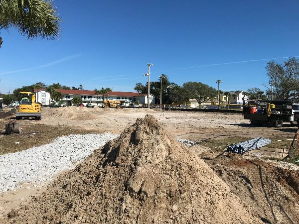 Dirt lot with heavy equipment and surveying machinery