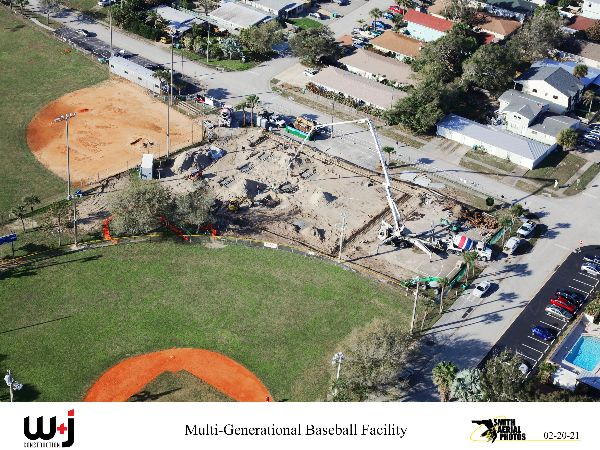 Birds eye view of construction site with concrete pump putting concrete in a hole