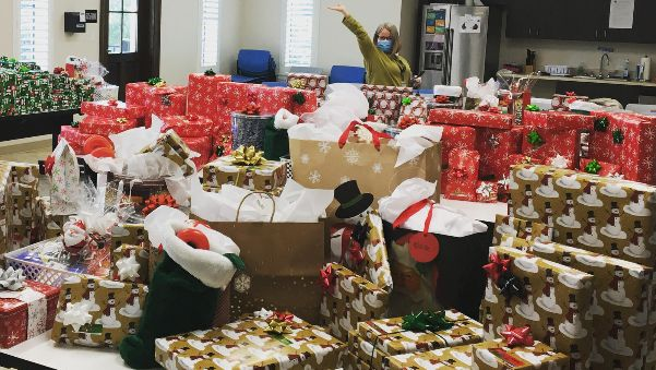 woman with roomful of wrapped presents
