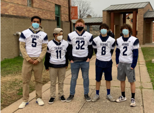 Five members of the Rangers football team are standing together, sporting their face masks and TSD football jerseys.