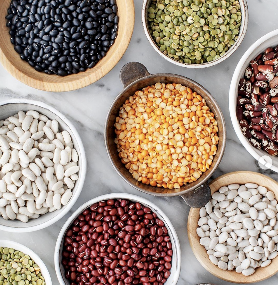different dried beans in various bowls