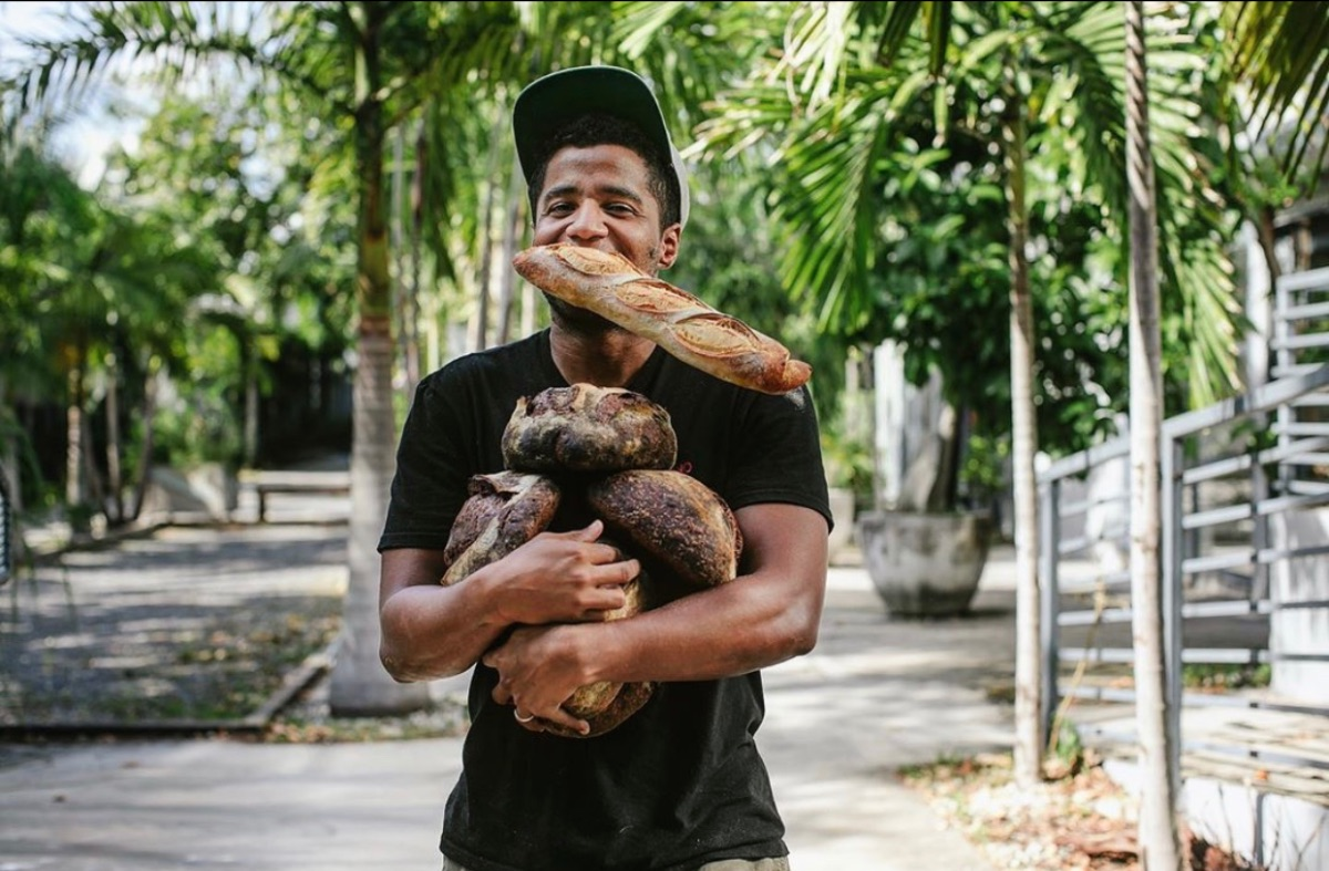 2019 Saveur Magazine baking blog winner, Bryan Ford holding lots of bread