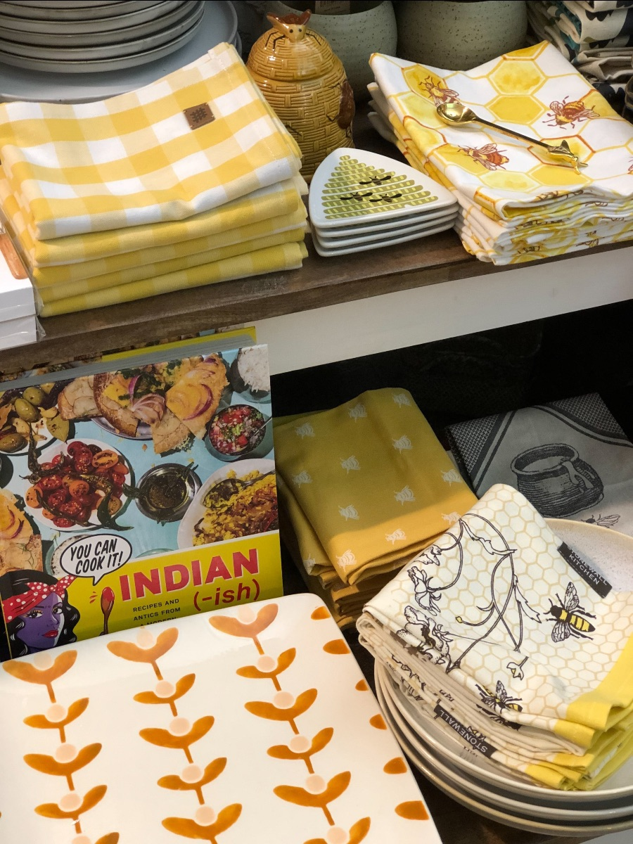 Indian-ish cookbook and bee themed towels and dishes