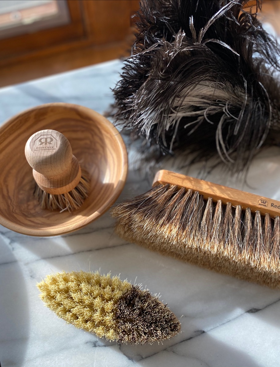 wood cleaning brushes in dappled sunlight