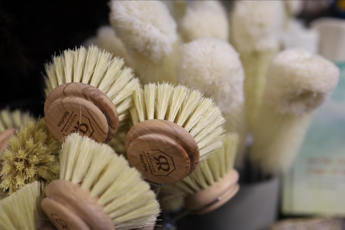 Natural fiber and wood Redekker cleaning brushes in crocks