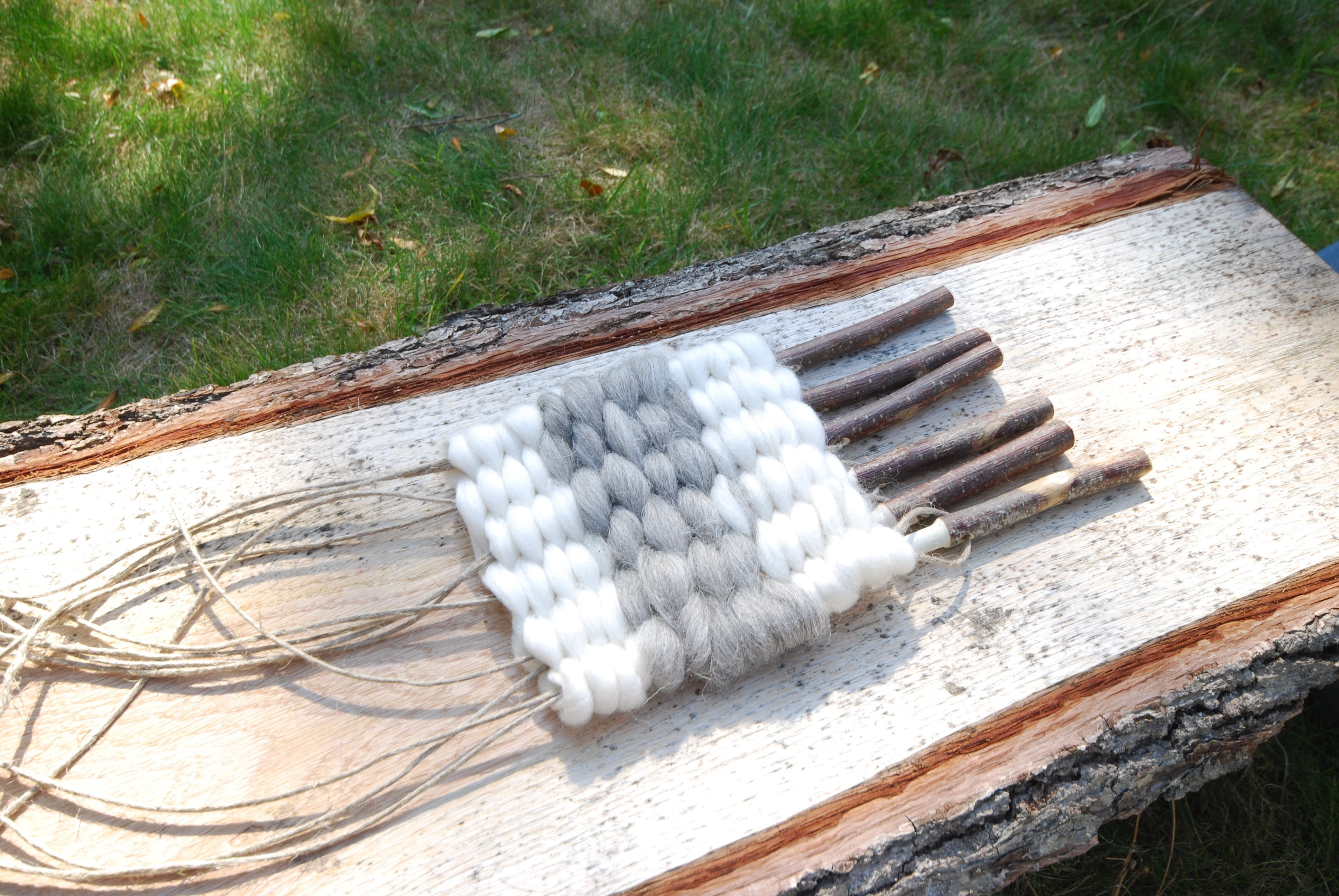 woven wool fibres laid on a wooden board