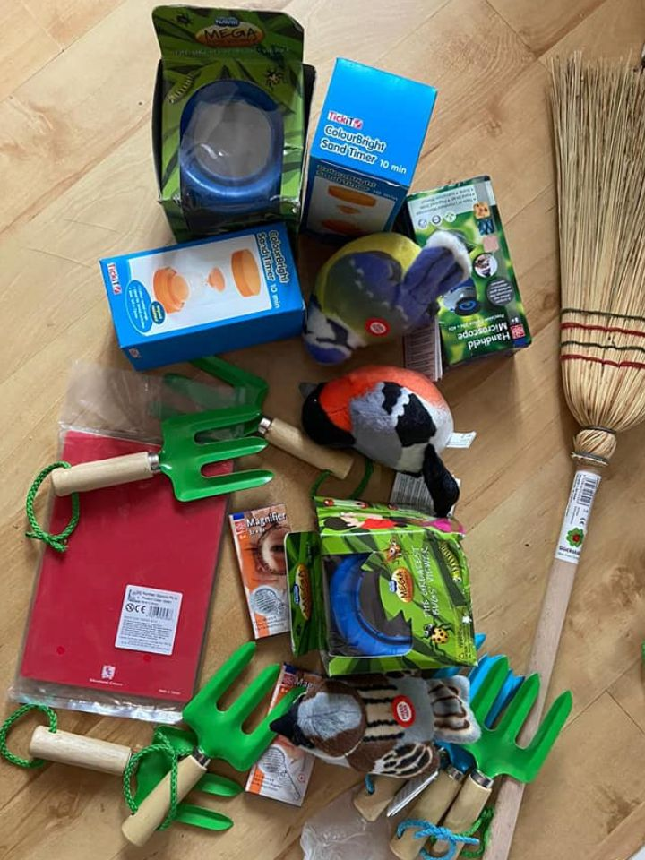 child sized garden forks, a broom, bug viewer and other forest school kit
