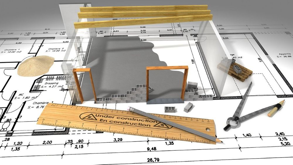 building plans with drawing equipment