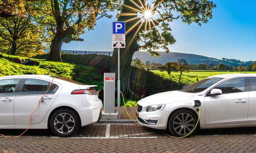 2 electric cars connected to roadside charger