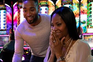 man and woman at a casino