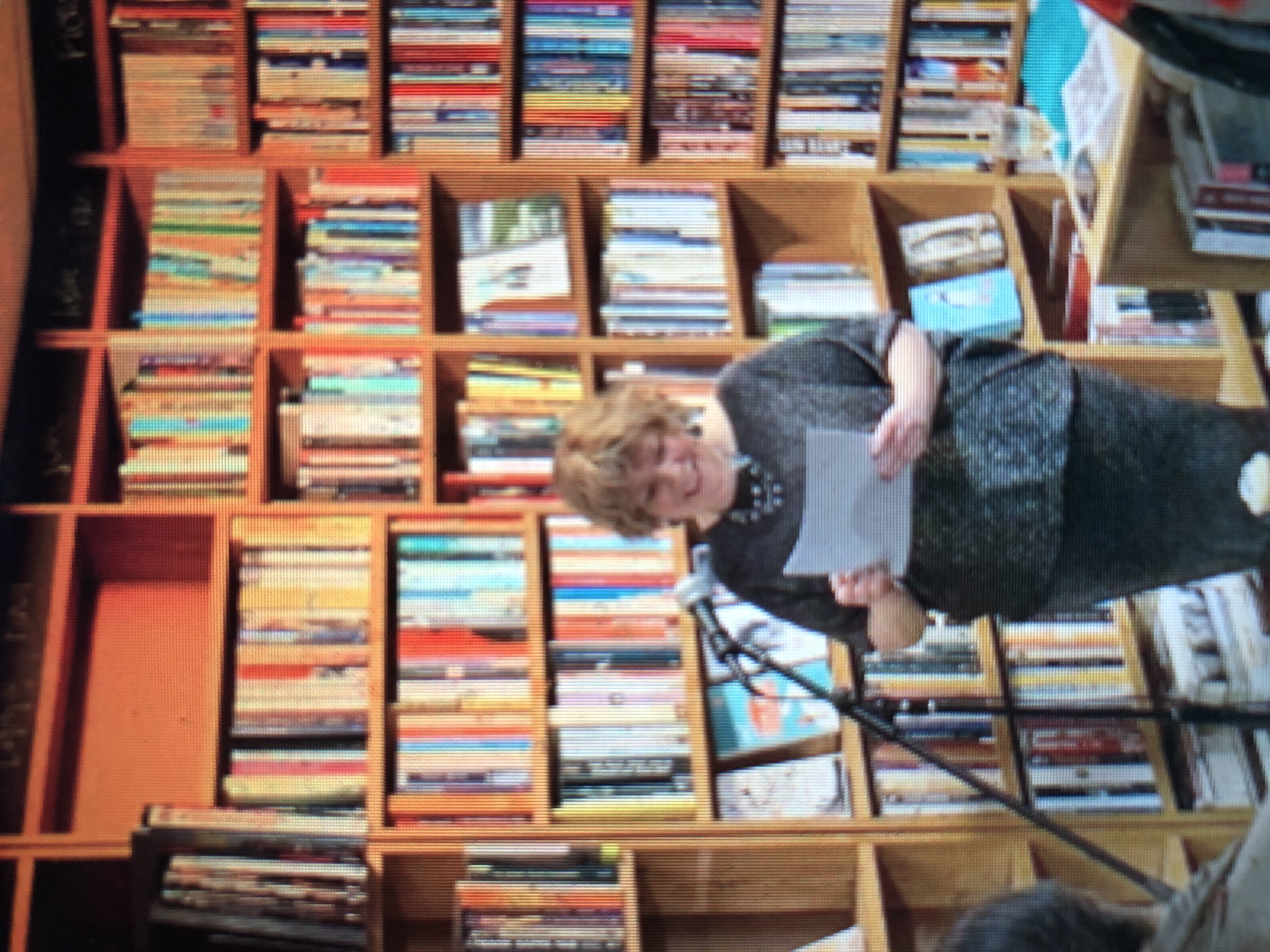 Anne Coates speaking at event in a bookshop