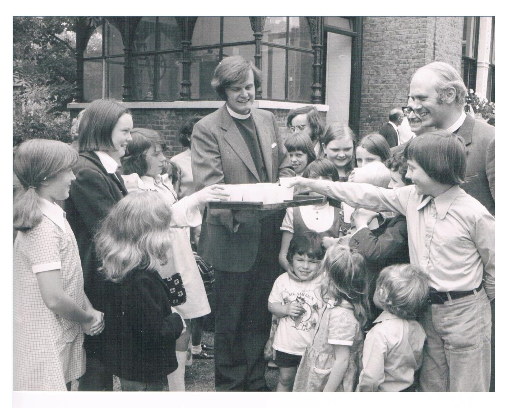 Photo of children with James Atwell in 1970s