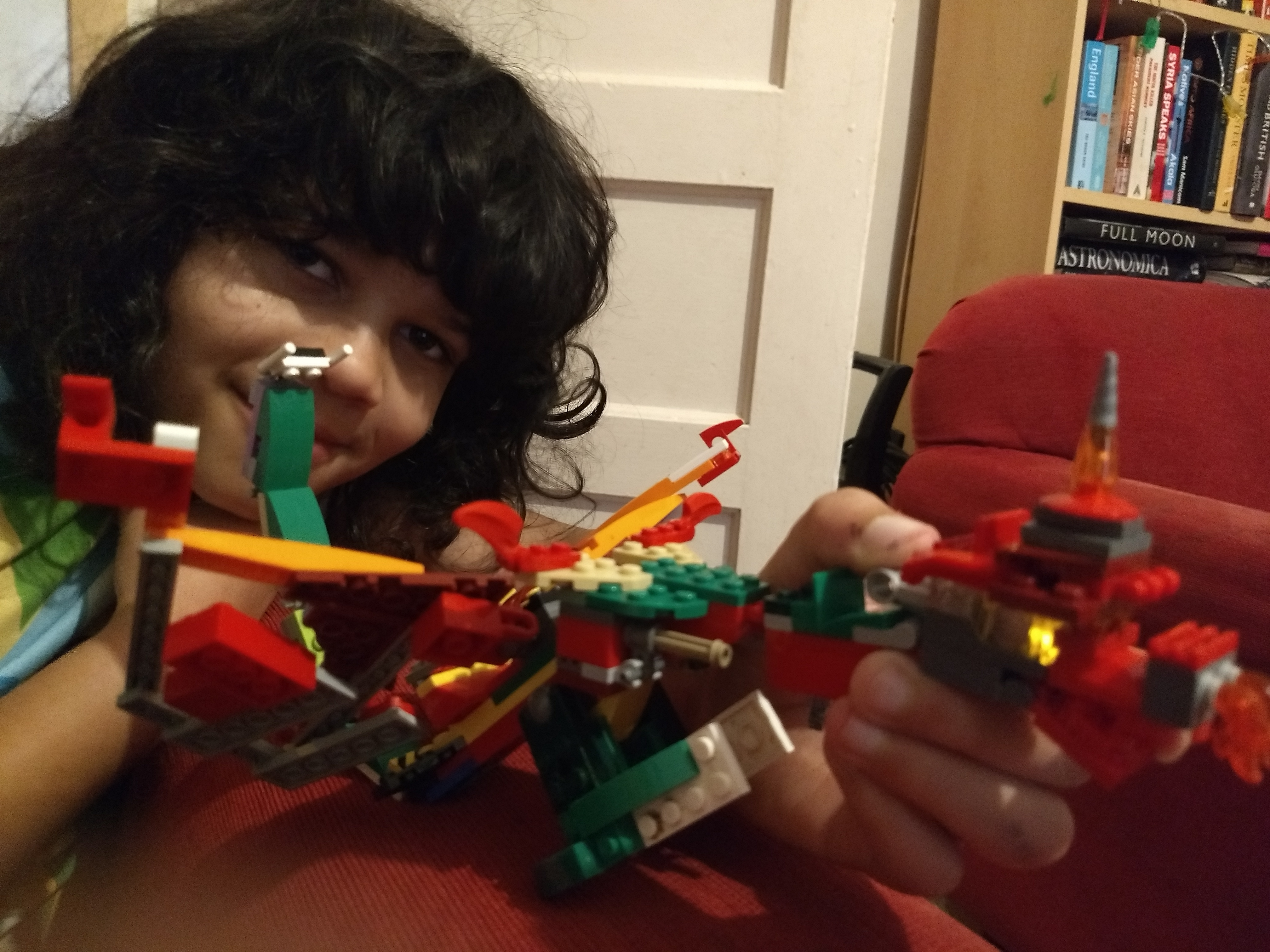 Errol holding his Scarlet emerald fire dragon made of lego