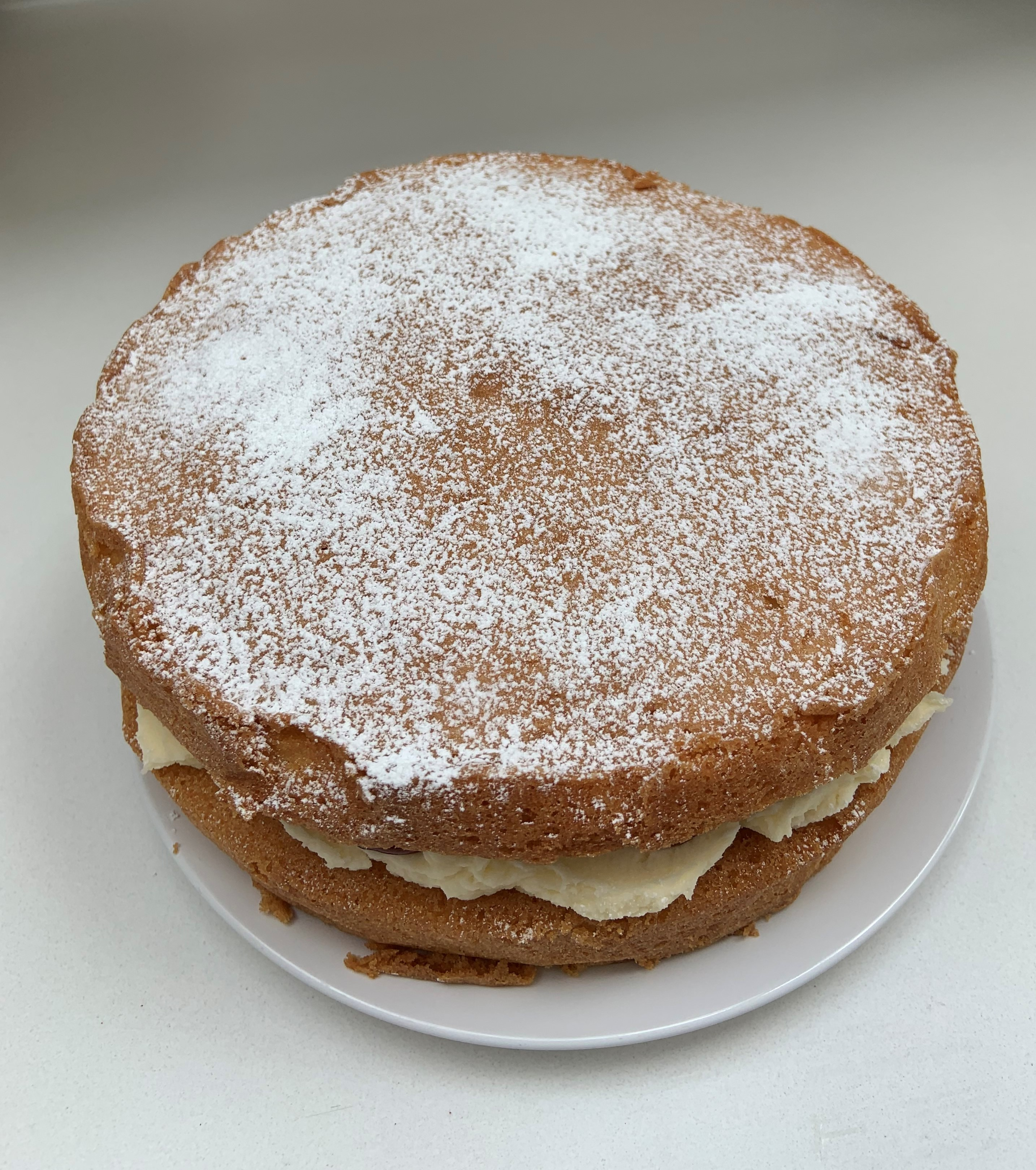 Picture of a Victoria sandwich which resembles two sponge cakes with cream in the middle