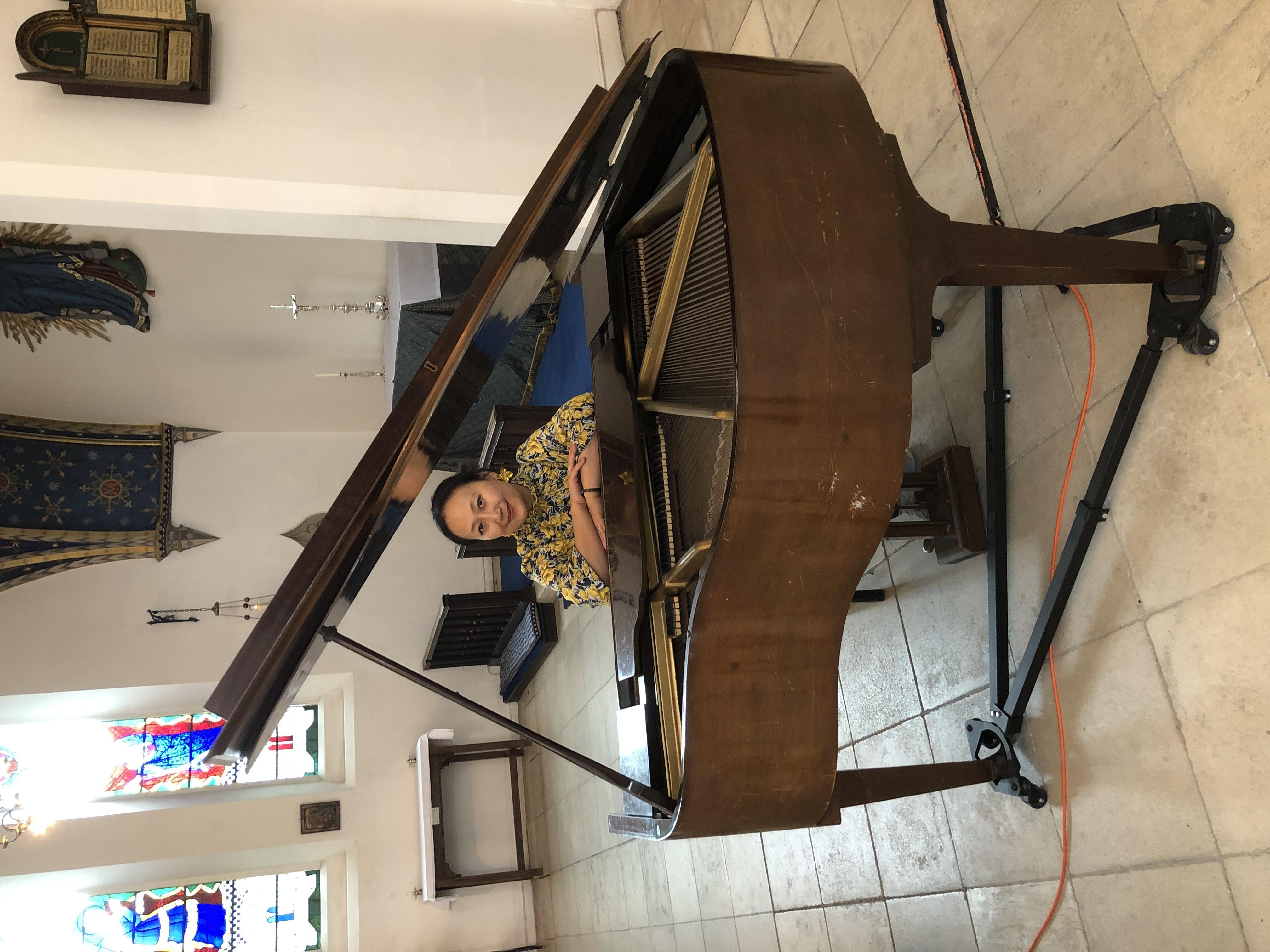 Photo of Miaomiao Yu at piano in St John's