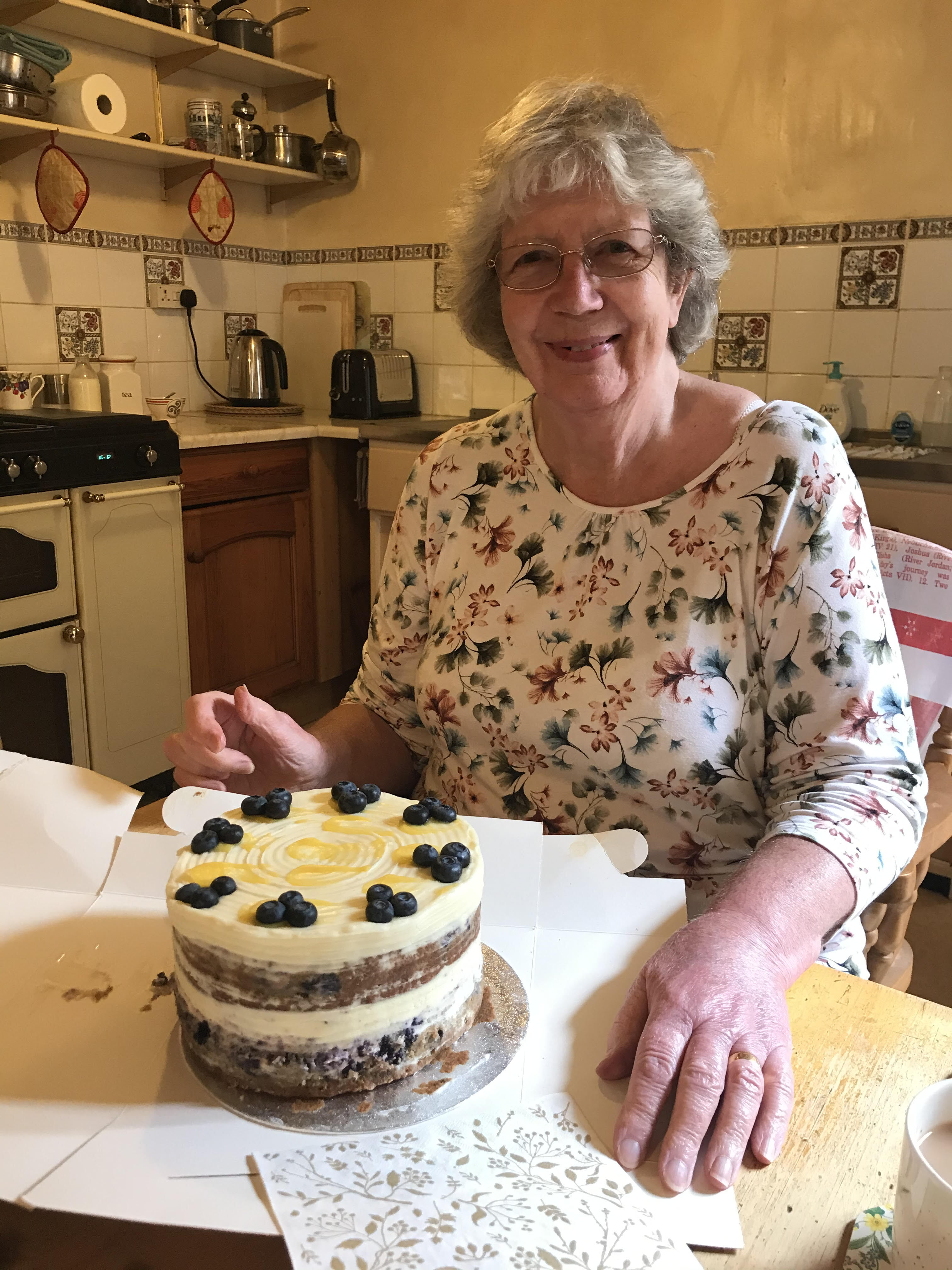 Photo of Sue Lock with homemade cake