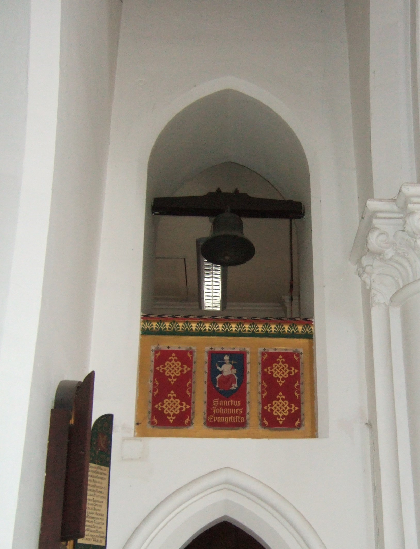 Bell in minstrels gallery at St John's as seen from nave
