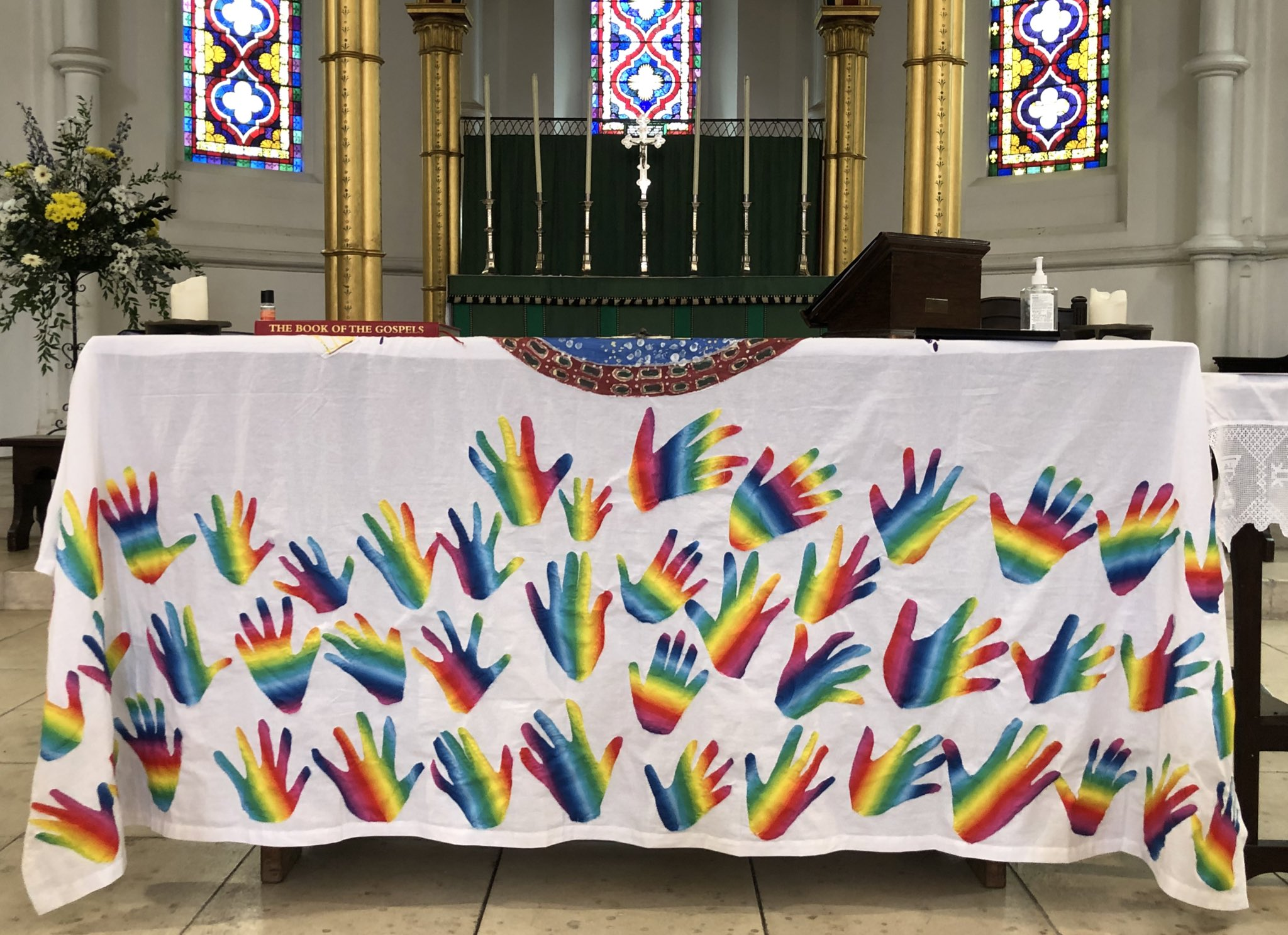 Photo of altar frontal with coloured hands