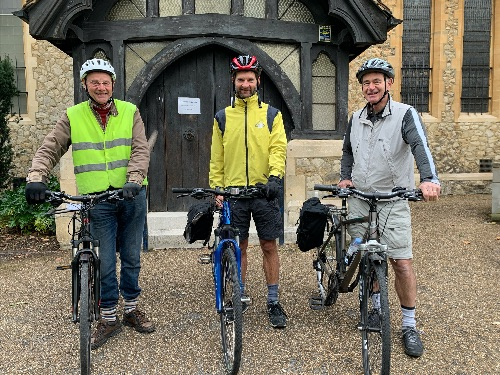 3 Church members with their bikes