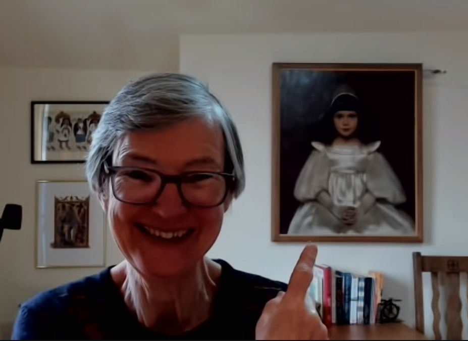 Revd Anne Clarke with the painting of Clare in the background