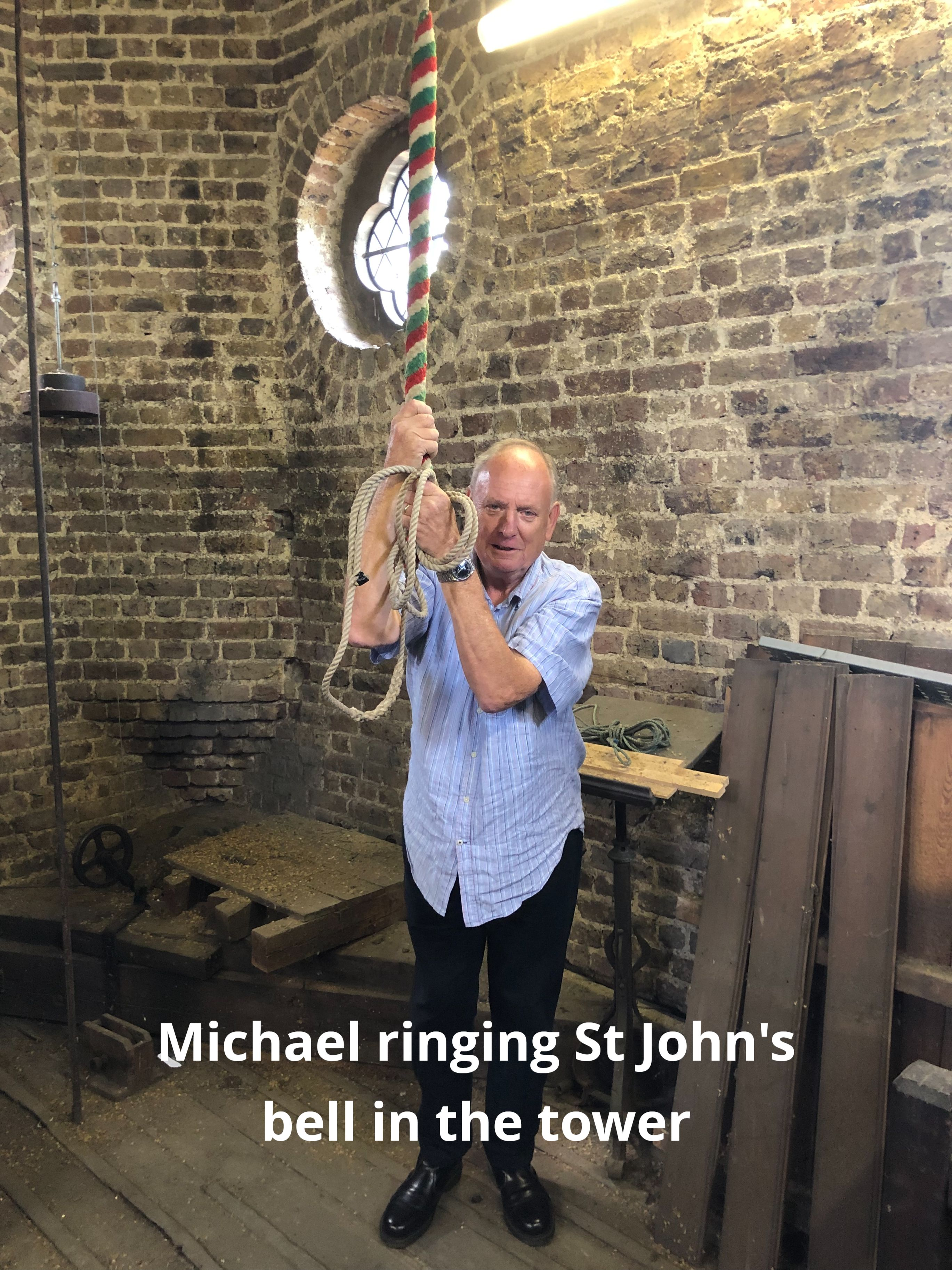 Michael Robinson ringing the tower bell