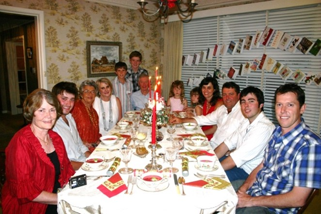 Large family sitting down to Christmas dinner