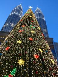 Petronas twin towers in Malaysia with towering Christmas tree