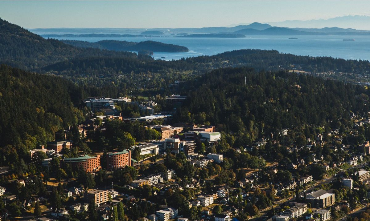 Aerial view of Western's campus, with the Salish Sea in the background.