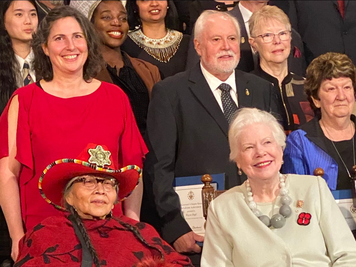 A photo of Evadne Kelly, Mona Stonefish, and other award recipients with the Lieutenant Governor, The Honourable Elizabeth Dowdeswell.