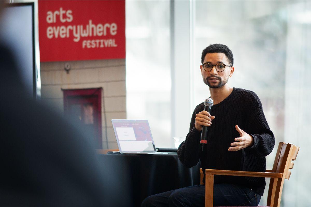 Photo of Stephen Surlin presenting at ArtsEverywhere.