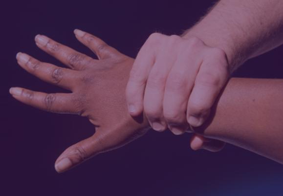 Hand grabbing a wrist