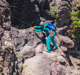 Rock Climber in Aqua-Colored Outfit