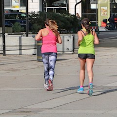 Two Women Running at Marble Arch London GB