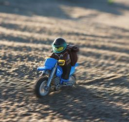 Lego Man on Lego Motorcycle in Sand