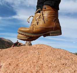 Hiking Boots Jumping Straight Up from Rock