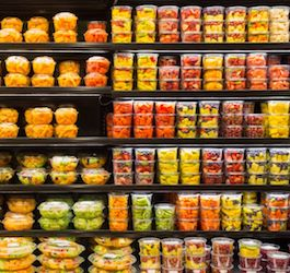 Grocery Shelves with Pre-cut Fruit