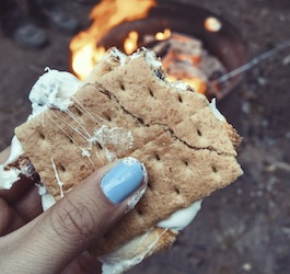 Woman Holding S'mores near Campfire