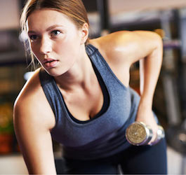 Woman Leaning Over and Exercising with Dumbbells