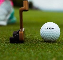 Closeup of Putter and Golf Ball on Artificial Grass